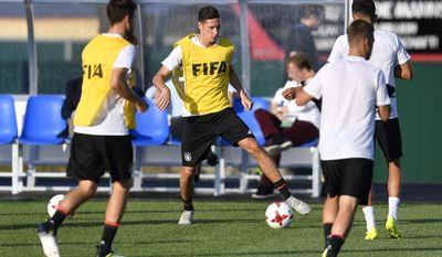 Germany's Julian Draxler, center, exercises with the national team in Sochi, Russia, on Wednesday, June 28, 2017. Germany will play Mexico in a Confederations Cup semifinal soccer match scheduled for Thursday June 29, 2017 in Sochi. (AP Photo/Martin Meissner)