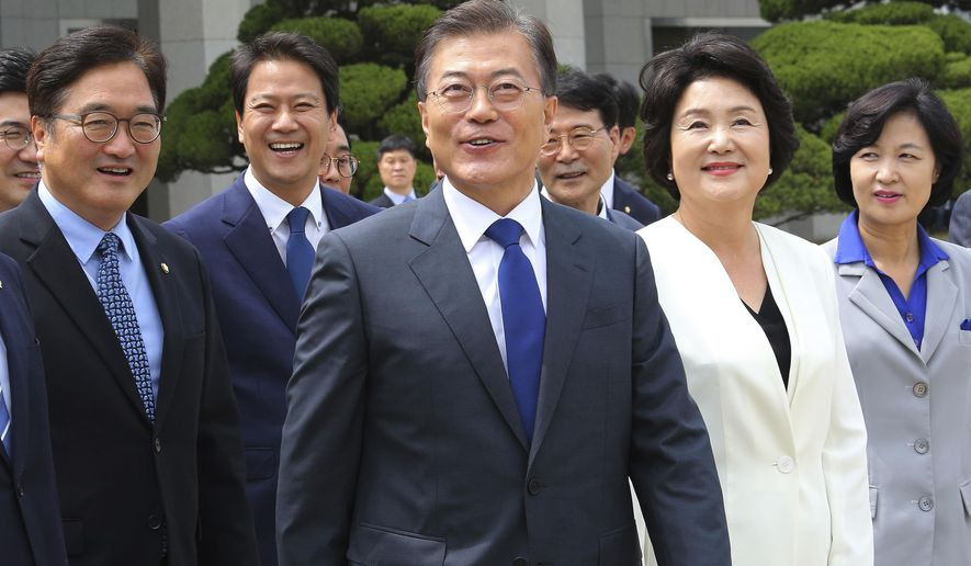 South Korean President Moon Jae-in, center, arrives to leave for the United States at the Seoul military airport in Seongnam, South Korea, Wednesday, June 28, 2017. Moon left for the United States for a summit meeting with his U.S. counterpart Donald Trump to discus the controversial U.S. missile defense system and North Korea's nuclear issues. (AP Photo/Ahn Young-joon)