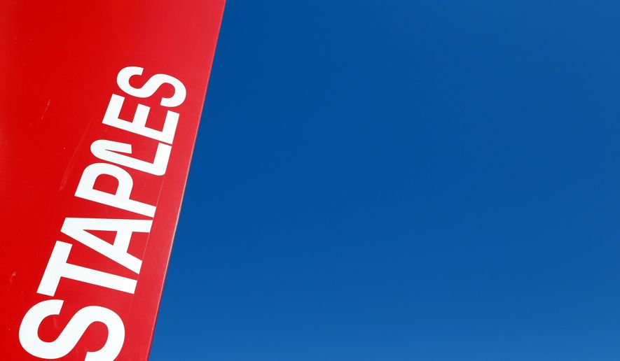 FILE - This Tuesday, March 1, 2016, file photo, shows a Staples store sign in New York. On Wednesday, June 28, 2017, private equity firm Sycamore announced it is buying office supplies chain Staples for $6.9 billion. (AP Photo/Mark Lennihan, File)