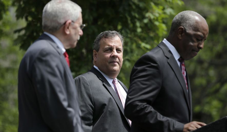 New Jersey Gov. Chris Christie, center, waits to speak during a news conference in Trenton, N.J., Tuesday, June 27, 2017. The Supreme Court agreed Tuesday to take up New Jersey's bid to allow sports betting at its casinos and racetracks, a case that could lead other states to seek a share of the lucrative market. Christie and supporters in the state Legislature have tried for years to legalize sports gambling. (AP Photo/Seth Wenig)