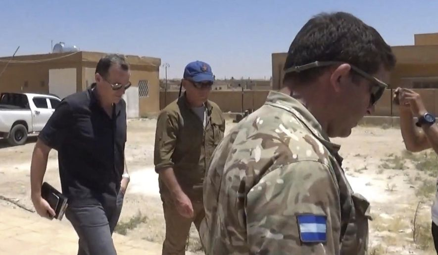 This frame grab from video released Wednesday June 28, 2017, by ANHA news agency for the semi-autonomous Kurdish areas in Syria, that is consistent with independent AP reporting, shows Brett McGurk, left, the top U.S. envoy for the international coalition combatting the Islamic State group, leaving after a visit to  Ayn Issa, Syria. McGurk met with members of a local council expected to administer the city of Raqqa in Syria following its capture from the militants. (ANHA News Agency, via AP)