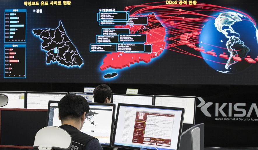 FILE - In this Monday, May 15, 2017, file photo, employees watch electronic boards to monitor possible ransomware cyberattacks at the Korea Internet and Security Agency in Seoul, South Korea. Unable to rely on good human behavior, computer security experts are developing software techniques to fight ransomware. But getting these protections in the hands of users is challenging. (Yun Dong-jin/Yonhap via AP, File)
