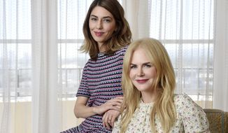 "In this June 13, 2017 photo, Sofia Coppola, left, writer/director of ""The Beguiled,"" and cast member Nicole Kidman pose together for a portrait at the Four Seasons Hotel in Los Angeles. (Photo by Chris Pizzello/Invision/AP)"