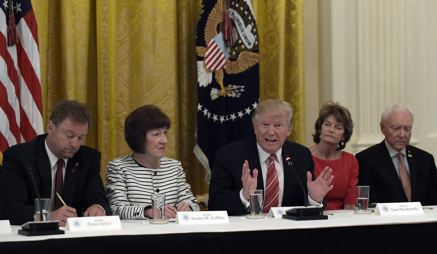President Donald Trump, center, speaks as he meets with Republican senators on health care in the East Room of the White House in Washington, Tuesday, June 27, 2017. Seated with him, from left, are Sen. Dean Heller, R-Nev., Sen. Susan Collins, R-Maine, Sen. Lisa Murkowski, R-Alaska, and Sen. Orrin Hatch, R-Utah. (AP Photo/Susan Walsh)