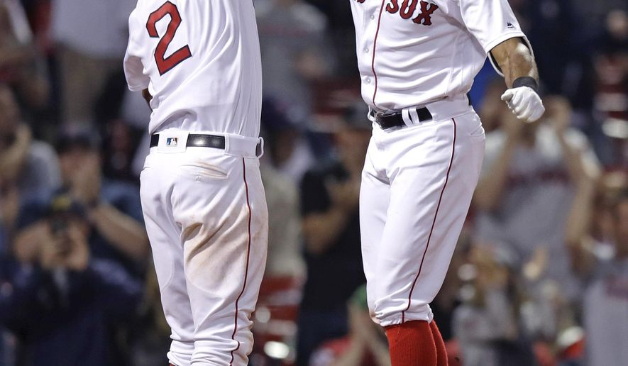 Boston Red Sox's Chris Young, right is congratulated by Xander Bogaerts (2) after his three-run home run during the sixth inning of the team's baseball game against the Minnesota Twins at Fenway Park in Boston, Tuesday, June 27, 2017. (AP Photo/Charles Krupa)