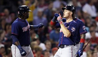 Minnesota Twins' Max Kepler, right, celebrates as he crosses home plate after his two-run home run off Boston Red Sox starting pitcher Rick Porcello during the sixth inning of a baseball game at Fenway Park in Boston, Wednesday, June 28, 2017. (AP Photo/Charles Krupa)