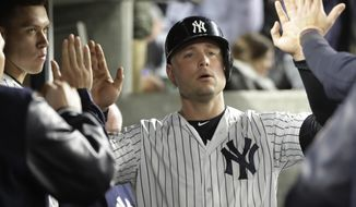 FILE- This June 6, 2017 file photo shows New York Yankees' Matt Holliday celebrating with teammates after scoring during the eighth inning of a baseball game against the Boston Red Sox in New York. Holliday joined Starlin Castro, Aaron Hicks and Greg Bird on the disabled list of the slumping New York Yankees due to a viral infection. Manager Joe Girardi said Wednesday, June 28, 2017 that Holliday returned to New York for more tests. Girardi said doctors ruled out mononucleosis. (AP Photo/Frank Franklin II, file)