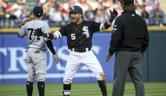 Chicago White Sox's Yolmer Sanchez (5) celebrates after hitting a double against the New York Yankees during the second inning of a baseball game Tuesday, June 27, 2017, in Chicago. (Armando L. Sanchez/Chicago Tribune via AP)