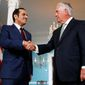 Secretary of State Rex Tillerson shakes hands with Qatari Foreign Minister Sheikh Mohammed bin Abdulrahman al-Thani Tuesday. Mr. Tillerson has tried to mediate the feud between Qatar and Saudi Arabia and suggested Saudi demands were too broad. (Associated Press)