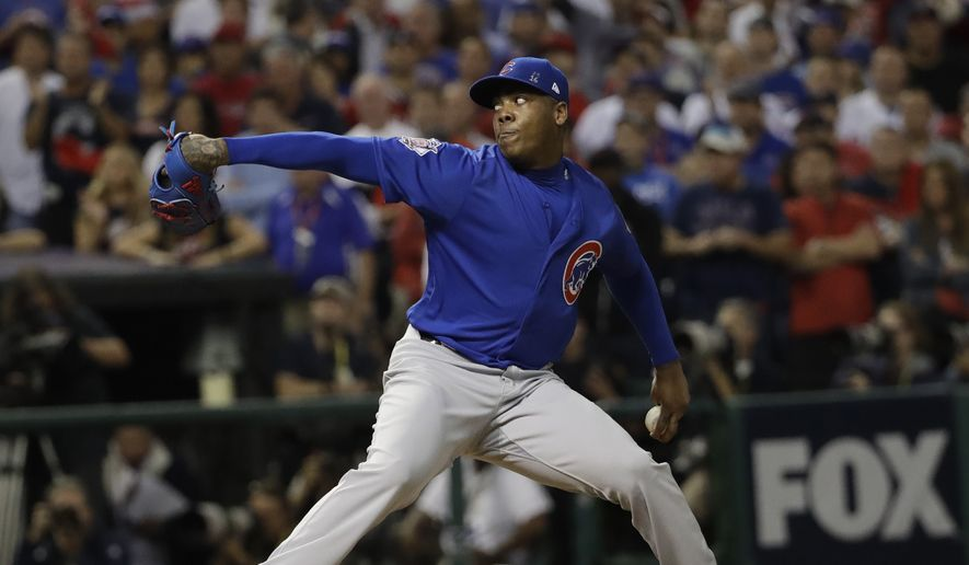 Chicago Cubs relief pitcher Aroldis Chapman throws during the eighth inning of Game 7 of the Major League Baseball World Series against the Cleveland Indians Wednesday, Nov. 2, 2016, in Cleveland. (AP Photo/David J. Phillip)