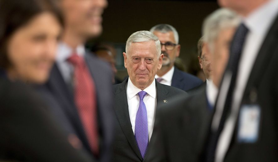 U.S. Secretary for Defense Jim Mattis, center, arrives for a meeting of NATO defense ministers at NATO headquarters in Brussels on Thursday, June 29, 2017. NATO defense ministers met Thursday to discuss, among other issues, the situation in Afghanistan and defense spending. (AP Photo/Virginia Mayo)