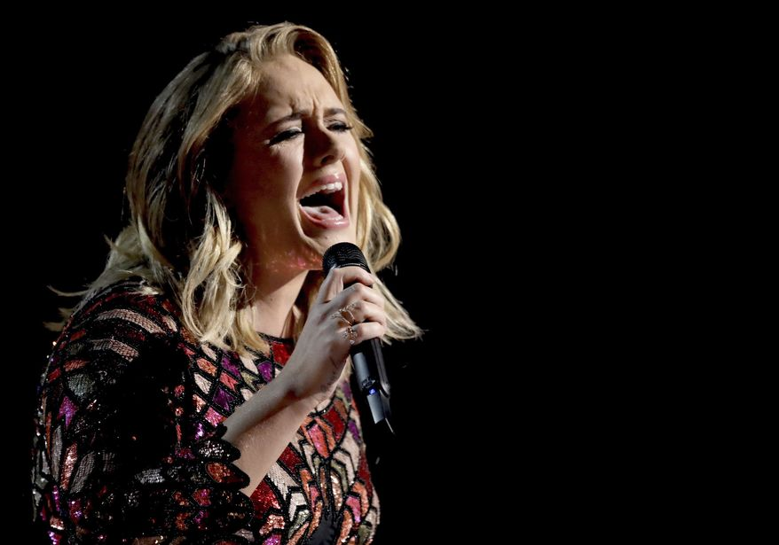 "Pop superstar Adele performs ""Hello"" at the 59th annual Grammy Awards in Los Angeles in this Feb. 12, 2017, file photo. She hinted that her current tour for Grammy-winning album ""25"" will be her last. The 29-year-old included a signed, handwritten note in the program for her Wednesday June 28, 2017, show at Wembley Stadium in London stating, ""I don't know if I'll ever tour again and so I want my last time to be at home."" (Photo by Matt Sayles/Invision/AP, File)"