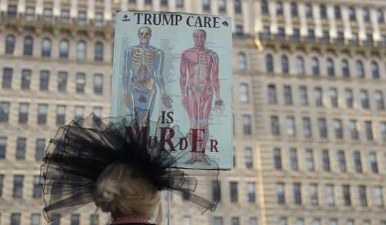 A person demonstrates against the GOP health care bill, Thursday, June 29, 2017, in Philadelphia. Senate Republican leaders considered keeping one of former President Barack Obama's big tax increases on wealthier Americans and using the money to fatten proposed subsidies for the poor in a bid Thursday to placate moderate GOP lawmakers and salvage their struggling health care bill. (AP Photo/Matt Slocum)