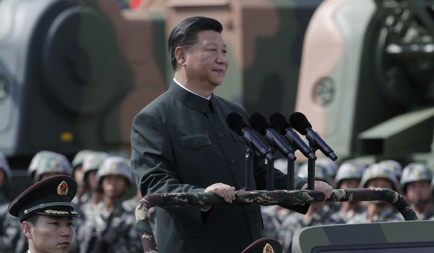Chinese President Xi Jinping inspects Chinese troops of People's Liberation Army (PLA) Hong Kong Garrison at the Shek Kong Barracks in Hong Kong, Friday, June 30, 2017. (AP Photo/Kin Cheung) ** FILE **