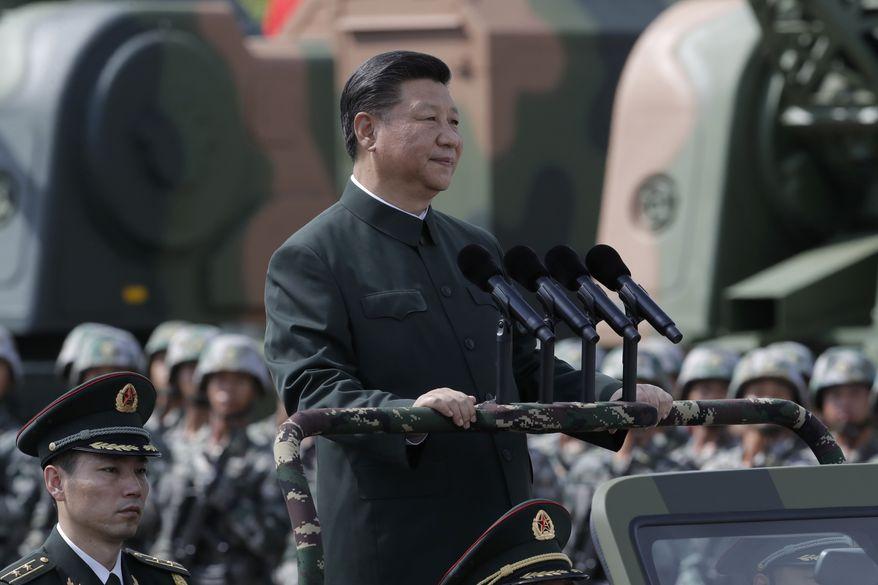 Chinese President Xi Jinping inspects Chinese troops of People's Liberation Army (PLA) Hong Kong Garrison at the Shek Kong Barracks in Hong Kong, Friday, June 30, 2017. (AP Photo/Kin Cheung) ** FILE **