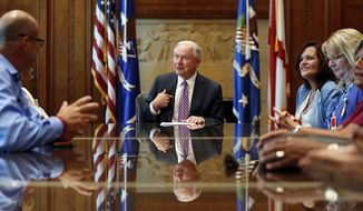 """Attorney General Jeff Sessions meets with families of victims killed by people living in the United States without legal permission at the Department of Justice, Thursday, June 29, 2017, in Washington. The Republican-led House is pushing ahead on legislation to crack down on illegal immigration. One bill would strip federal funds from """"sanctuary"""" cities that shield residents from federal immigration authorities. (AP Photo/Alex Brandon)"""