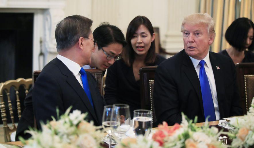President Donald Trump listens to South Korean President Moon Jae-in, left, during a dinner in the State Dining Room of the White House in Washington, Thursday, June 29, 2017. (AP Photo/Manuel Balce Ceneta)