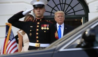 President Donald Trump and first lady Melania Trump watch the limousine carrying South Korean President Moon Jae-in and his wife Kim Jung-sook arrive on the South Portico of the White House in Washington, Thursday, June 29, 2017. Trump and the first lady is hosting Moon and his wife for dinner. (AP Photo/Manuel Balce Ceneta)