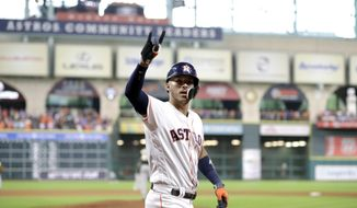 Houston Astros' Carlos Correa celebrates after hitting a two-run home run against the Oakland Athletics during the sixth inning of a baseball game Thursday, June 29, 2017, in Houston. (AP Photo/David J. Phillip)