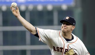 Houston Astros starting pitcher Brad Peacock throws against the Oakland Athletics during the first inning of a baseball game Thursday, June 29, 2017, in Houston. (AP Photo/David J. Phillip)