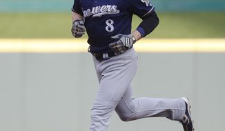 Milwaukee Brewers' Ryan Braun runs the bases after hitting a solo home run off Cincinnati Reds starting pitcher Homer Bailey during the first inning of a baseball game, Thursday, June 29, 2017, in Cincinnati. (AP Photo/John Minchillo)