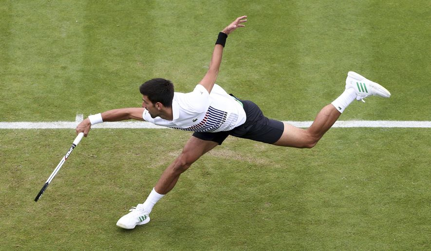 Serbia's Novak Djokovic in action during his match against Donald Young of the United States at the AEGON International tennis tournament  at Devonshire Park, Eastbourne, England Thursday June 29, 2017. (Gareth Fuller/PA via AP)