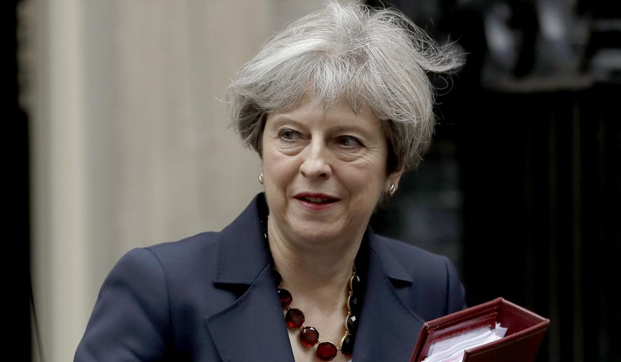 British Prime Minister Theresa May leaves 10 Downing Street in London, to attend Prime Minister's Questions at the Houses of Parliament, Wednesday, June 28, 2017. (AP Photo/Matt Dunham)