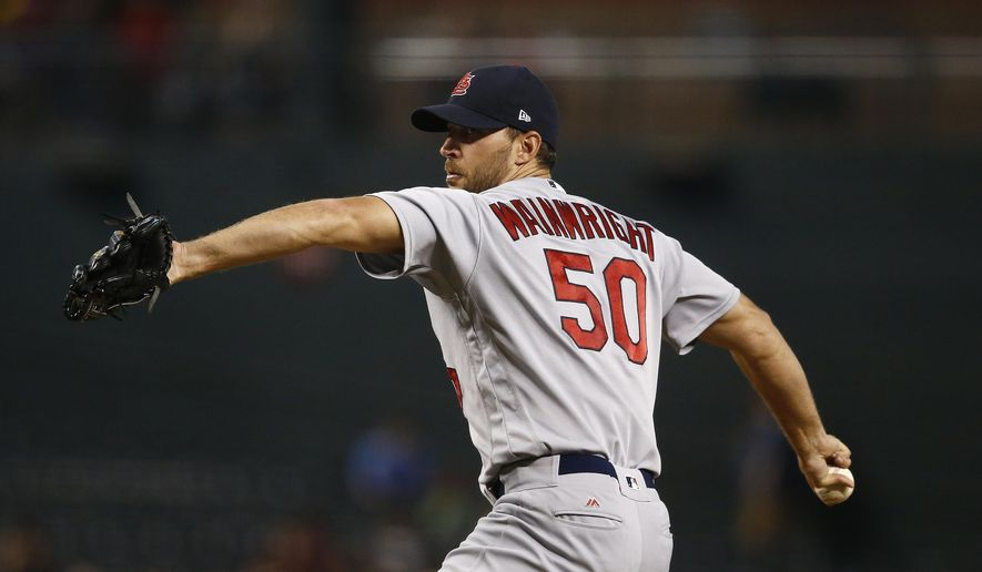 St. Louis Cardinals' Adam Wainwright throws a pitch against the Arizona Diamondbacks during the first inning of a baseball game, Wednesday, June 28, 2017, in Phoenix. (AP Photo/Ross D. Franklin)