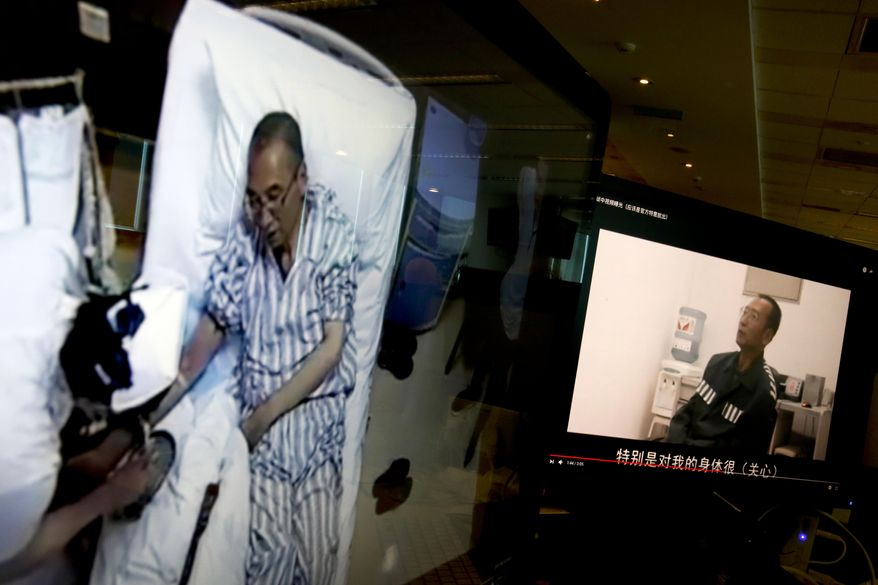 Video clips show China's jailed Nobel Peace laureate Liu Xiaobo lying on a bed receiving medical treatment at a hospital, left, and Liu saying wardens take good care of him, on a computer screens in Beijing, Thursday, June 29, 2017. An online video without clear provenance but certainly shot by Chinese authorities has shown Liu thanking wardens for taking care of his health, in an apparent response to criticisms that Beijing has failed to provide sufficient health care to China's most prominent political prisoner. (AP Photo/Andy Wong)