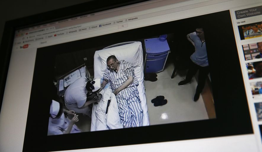 A video clip shows China's jailed Nobel Peace laureate Liu Xiaobo lying on a bed receiving medical treatment at a hospital on a computer screen in Beijing, Thursday, June 29, 2017. An online video without clear provenance but certainly shot by Chinese authorities has shown Liu thanking wardens for taking care of his health, in an apparent response to criticisms that Beijing has failed to provide sufficient health care to China's most prominent political prisoner. (AP Photo/Andy Wong)
