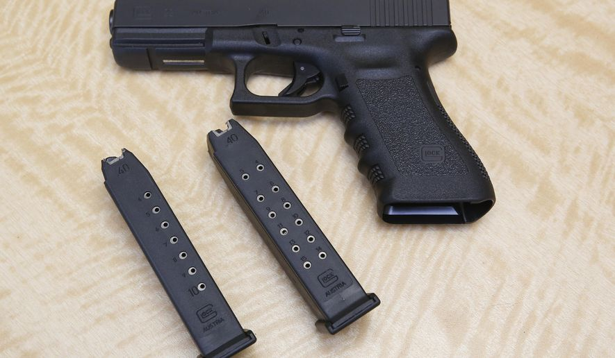 In this Tuesday, June 27, 2017 file photo, a semi-automatic hand gun is displayed with a 10 shot magazine, left, and a 15 shot magazine, right, at a gun store in Elk Grove, Calif.  (AP Photo/Rich Pedroncelli) **FILE**