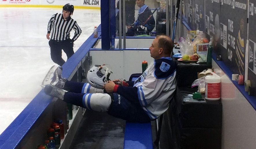 Andrew Tokasz puts his feet up to catch a breather as Team White's only substitute as the 11-day hockey marathon entered its seventh day in Buffalo, N.Y., early Thursday, June 29, 2017. Having overcome blisters and lack of sleep, a group of 40 Buffalo hockey players are trying to raise money for cancer research and break the record for longest continuous game. (AP Photo/John Wawrow)