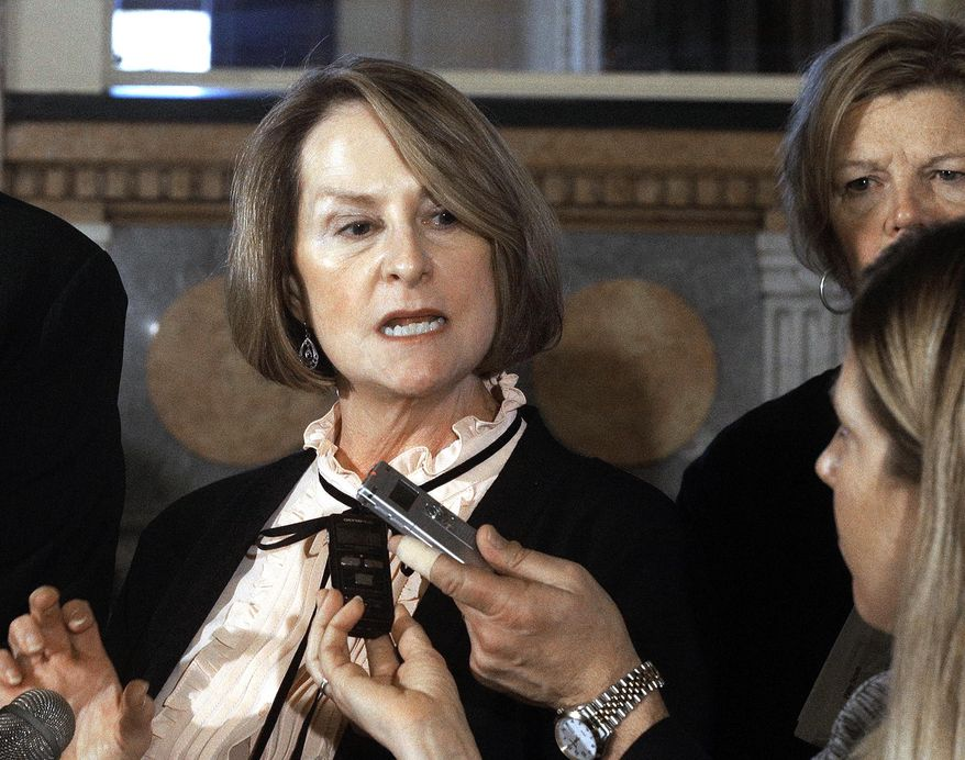FILE - In this Nov. 30, 2016, file photo, Illinois Senate Minority Leader Christine Radogno, R-Lemont speaks to reporters at the Capitol in Springfield, Ill. In a statement issued Thursday, June 29, 2017, Radogno said that she will step down as senator on Saturday, July 1. (AP Photo/Seth Perlman, File)