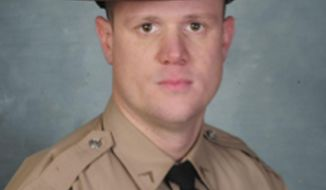 This undated photo provided by The Illinois State Police shows State Trooper Ryan Albin. State police say Albin has died after being injured in a crash involving a semi-truck Wednesday, June 28, 2017, near Farmer City, Ill. (Illinois State Police via AP)