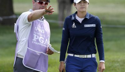 Sung Hyun Park, of South Korea, listens to caddie David Jones on the 18th green during the first round of the 2017 Women's PGA Championship golf  tournament at the Olympia Fields Country Club Thursday, June 29, 2017, in Olympia Fields, Ill. (AP Photo/Charles Rex Arbogast)
