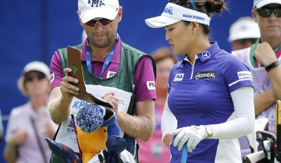 So Yeon Ryu, of South Korea, right, listens to her caddie Tom Watson before teeing off in the first round of the 2017 Women's PGA Championship golf tournament at the Olympia Fields Country Club Thursday, June 29, 2017, in Olympia Fields, Ill. (AP Photo/Charles Rex Arbogast)