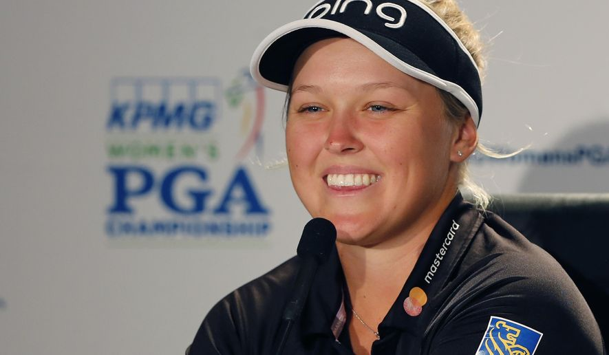 Brooke Henderson smiles as she fields questions from reporters during the practice round of the Women's PGA Championship golf tournament at Olympia Fields Country Club, Wednesday, June 28, 2017, in Olympia Fields, Ill. (AP Photo/Charles Rex Arbogast)