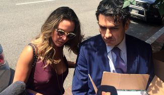 Mexican actress Kate del Castillo arrives to the headquarters of the Organization of American States in Washington on Thursday June 29, 2017.  Lawyer Federico Mery Sanson is on right.  (AP Photo/Luis Alonso Lugo)