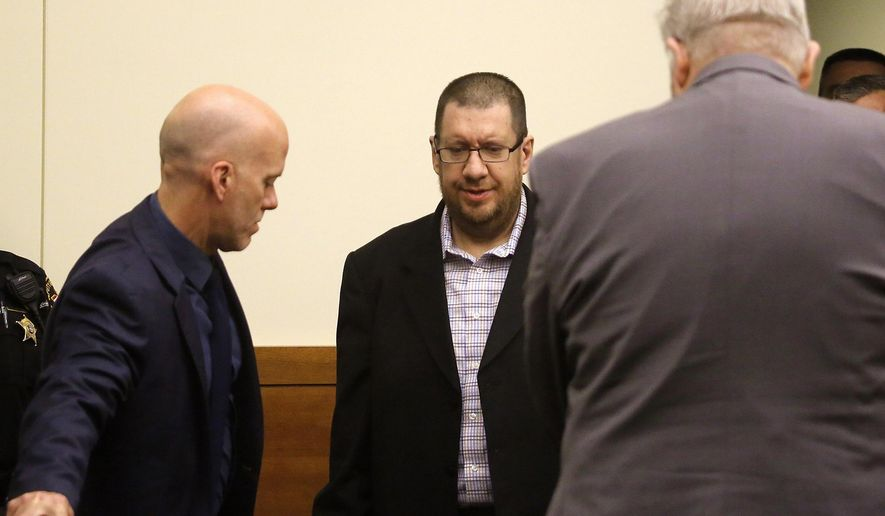 FILE - In this Thursday, June 22, 2017, file photo, Lincoln Rutledge, center, appears with his attorneys Mitch Williams, left, and Jefferson Liston, right shortly before the verdict in Columbus, Ohio. A jury on Thursday, June 29, recommended life in prison without parole for Rutledge, convicted of fatally shooting an Ohio SWAT officer during a standoff. (Tom Dodge/The Columbus Dispatch via AP, File)