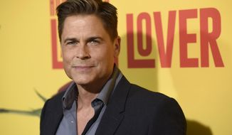 "FILE - In this April 26, 2017, file photo, Rob Lowe arrives at the Los Angeles premiere of ""How to Be a Latin Lover"" at the ArcLight Hollywood. Lowe told Entertainment Weekly in an interview published online June 27, 2017, that he feared death during an encounter with a bigfoot-like creature in the Ozark Mountains while shooting his upcoming A&E docuseries ""The Lowe Files."" (Photo by Chris Pizzello/Invision/AP, File)"