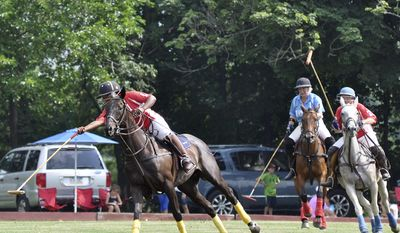 This undated photo provided by the Work to Ride program shows 19-year-old Shariah Harris, left, playing polo at the Polo Club in Lancaster, Pa. Harris, who grew up in single-parent home just outside of west Philadelphia, is set to become the first African American woman to play in a top-tier U.S. polo event when she mounts up Friday, June 30, 2017, for the Postage Stamp Farm polo team in the Silver Cup at the tony Greenwich Polo Club in Connecticut. (Lezlie Hiner/Work to Ride via AP)
