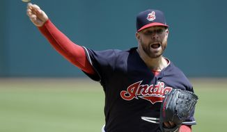 Cleveland Indians starting pitcher Corey Kluber delivers in the first inning of a baseball game against the Texas Rangers, Thursday, June 29, 2017, in Cleveland. (AP Photo/Tony Dejak)