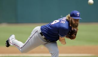 Texas Rangers starting pitcher Andrew Cashner delivers in the first inning of a baseball game against the Cleveland Indians, Thursday, June 29, 2017, in Cleveland. (AP Photo/Tony Dejak)