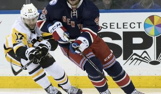 FILE - In this March 31, 2017, file photo, New York Rangers defenseman Brendan Smith (42) and Pittsburgh Penguins right wing Bryan Rust (17) battle for the puck during the first period of an NHL hockey game, at Madison Square Garden in New York. The Rangers have agreed to terms on a new deal with defenseman Brendan Smith. General manager Jeff Gorton announced the deal Thursday, June 29, 2017. (AP Photo/Mary Altaffer, File)
