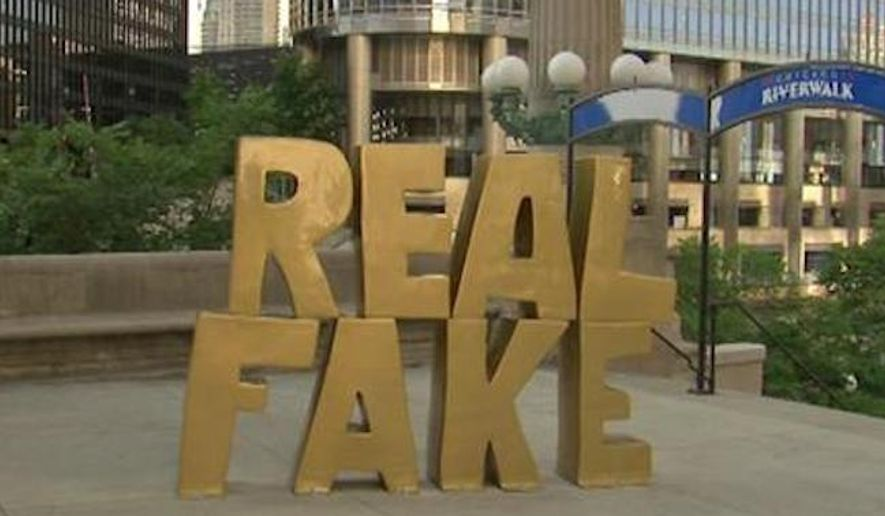 "Chicago has installed a gold-painted ""REAL FAKE"" statue in front of Trump Tower, but says its intent is up for interpretation. (WLS)"