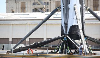 A SpaceX Falcon 9 Booster is brought to the Port Of Los Angeles Wednesday, June 28, 2017 after launching 10 Iridium satellites into orbit Sunday. The booster landed on a SpaceX drone ship off the coast of Mexico. (Daily Breeze/SCNG/Los Angeles Daily News via AP)