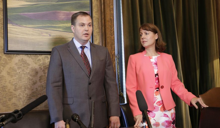 Republican Sens. John Braun and Ann Rivers talk to the media about the agreement reached on an education funding plan, Thursday, June 29, 2017 in Olympia, Wash. Lawmakers say their budget compromise satisfies a state Supreme Court ruling that says the state must spend more money on schools. (AP Photo/Rachel La Corte)