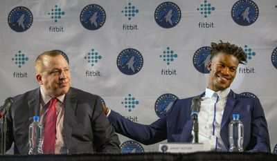 Minnesota Timberwolves new point guard Jimmy Butler, right, pats Timberwolves head coach Tom Thibodeau on the back during a press conference at Mall of America in Bloomington, Minn., on Thursday, June 29, 2017.(AP Photo/Andy Clayton-King)