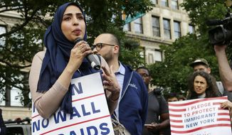 Yemeni American Wadid Hassan speaks to supporters who gathered to protest a travel ban in Union Square, Thursday, June 29, 2017, in New York. A scaled-back version of President Donald Trump's travel ban takes effect Thursday evening, stripped of provisions that brought protests and chaos at airports worldwide in January yet still likely to generate a new round of court fights.(AP Photo/Frank Franklin II)