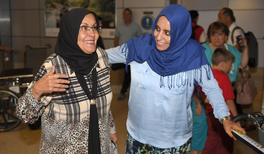 Hanadi Al-Haj, right, greets her Yemeni mother Amal Bagoon in the Tom Bradley International Terminal at Los Angeles International Airport as her mother arrives from Jordan via Istanbul, Thursday, June 29, 2017, in Los Angeles. A scaled-back version of President Donald Trump's travel ban took effect Thursday evening, stripped of provisions that brought protests and chaos at airports worldwide in January yet still likely to generate a new round of court fights. (AP Photo/Mark J. Terrill)